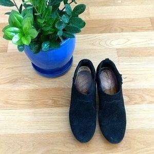 Black suede booties with wood-like heel